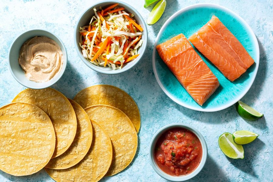 Salmon tacos with cabbage slaw, salsa roja, and chipotle yogurt