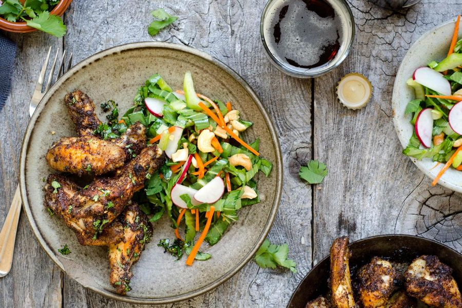Marrakech chicken wings with sesame–bok choy slaw and cashews