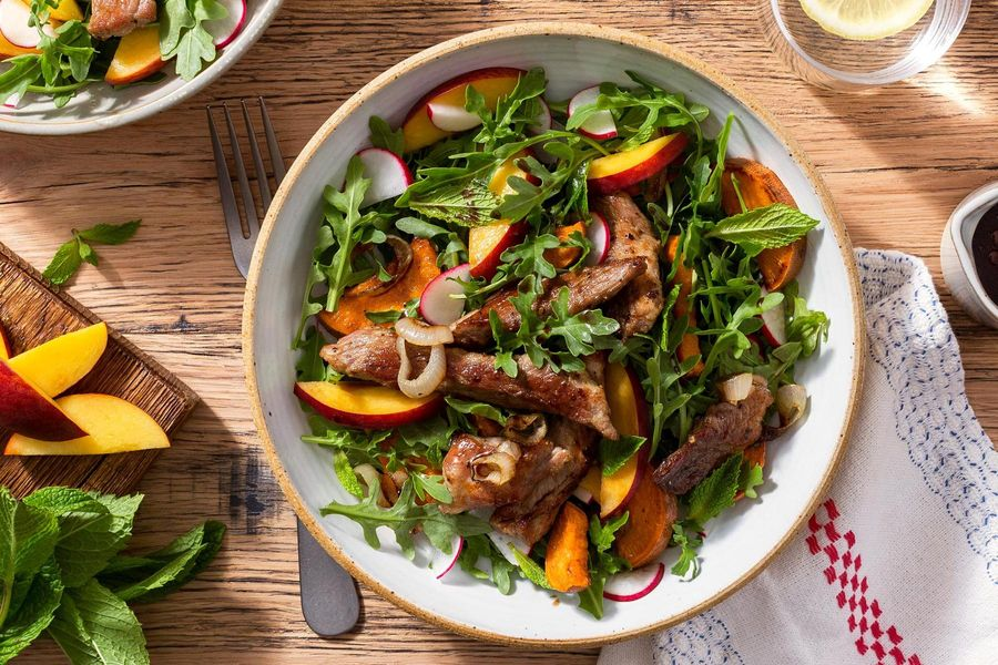 Seared pork and stone fruit salad with harissa-spiced sweet potato