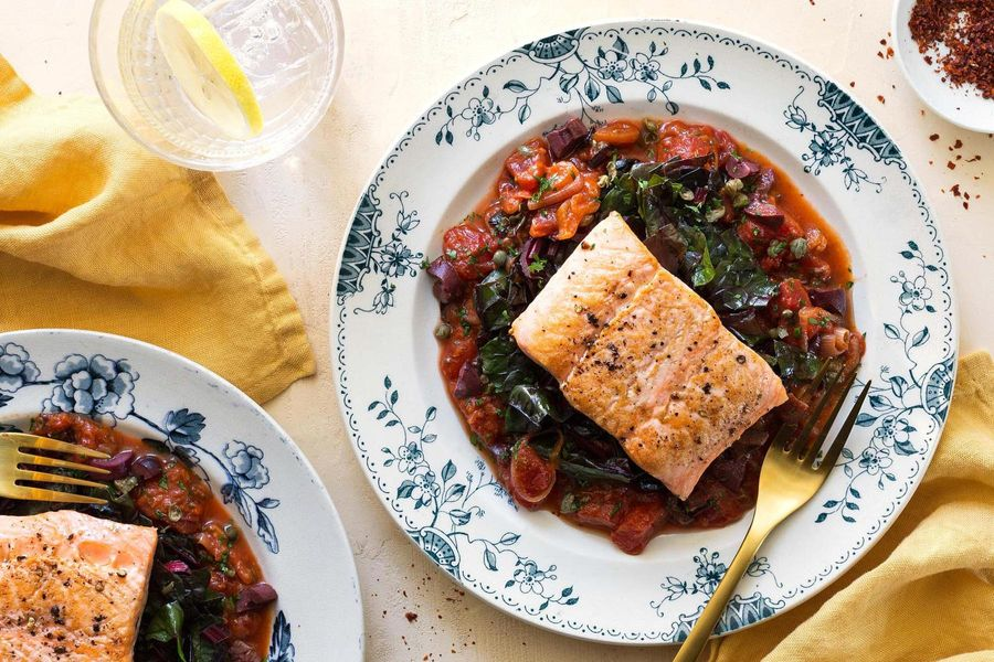 Salmon alla puttanesca with sautéed chard
