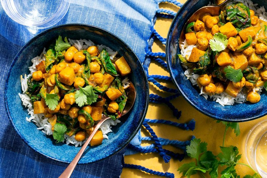 Curried chickpeas and sweet potato with chard over basmati rice