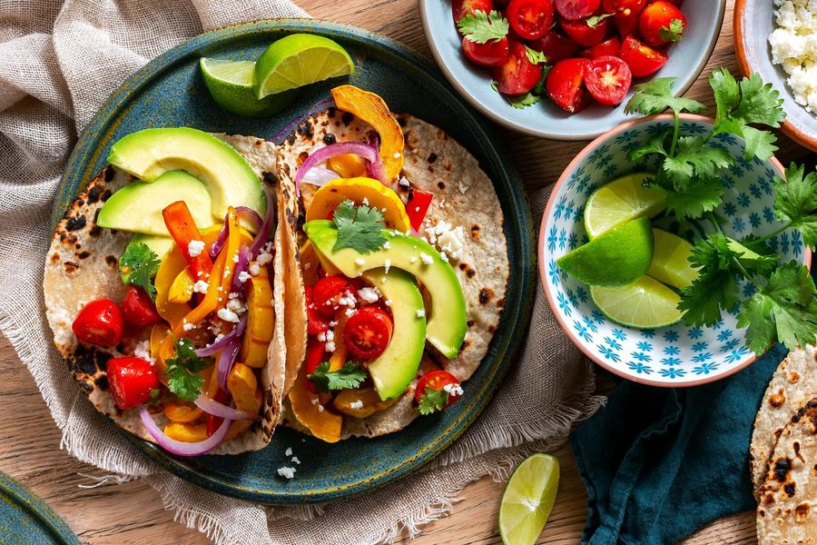 Simple squash fajitas with sweet peppers and queso fresco image