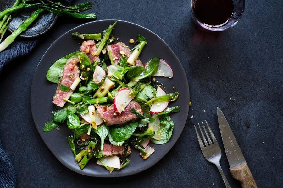 Steak salad with charred scallions and kimchi-spiced dressing