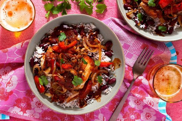 Belizean stewed chicken over coconut rice and beans