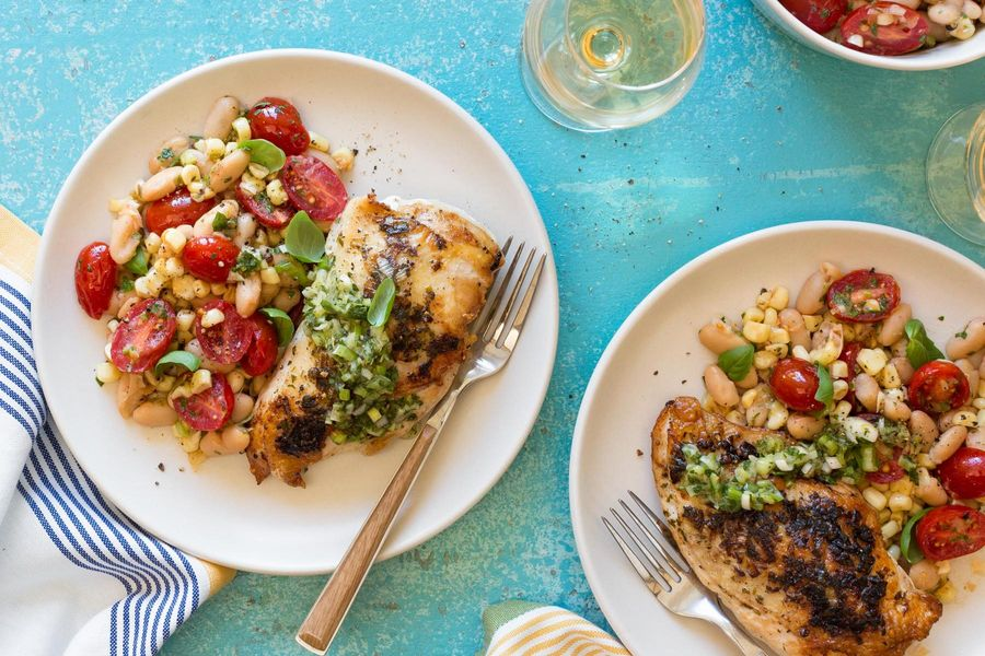 Seared chicken breasts with salsa verde and white bean salad