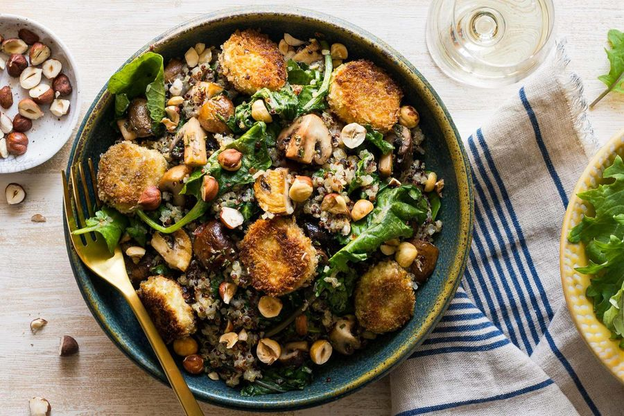 Quinoa bowls with kale, mushrooms, and goat cheese medallions