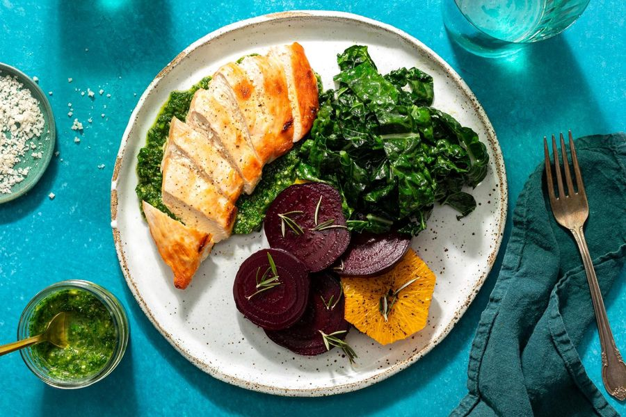 Chicken breasts and parsley-pecan pesto with roasted beet and orange