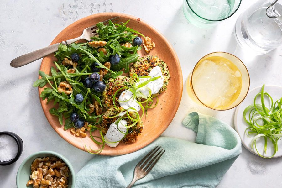 Quinoa fritters with arugula-blueberry salad and walnuts