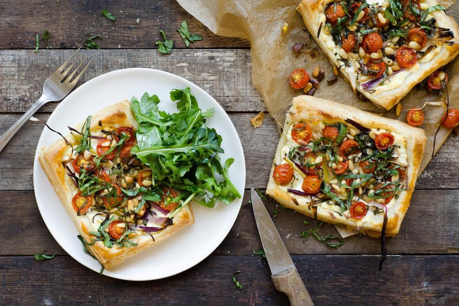 Spring onion, cherry tomato and lemon ricotta tarts with arugula salad
