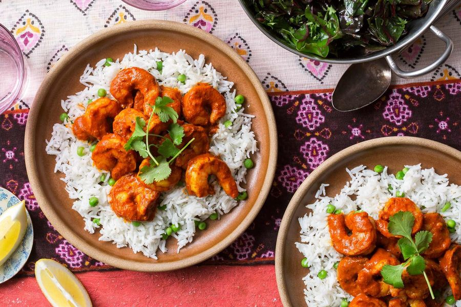 Shrimp tikka masala with basmati rice, peas, and chard