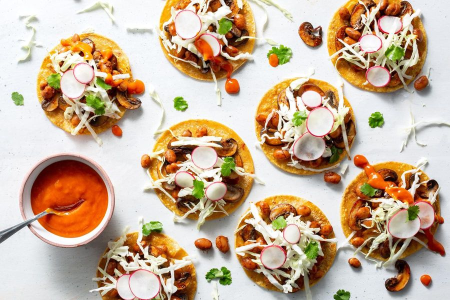 Mushroom tostadas with pinto beans and cabbage slaw