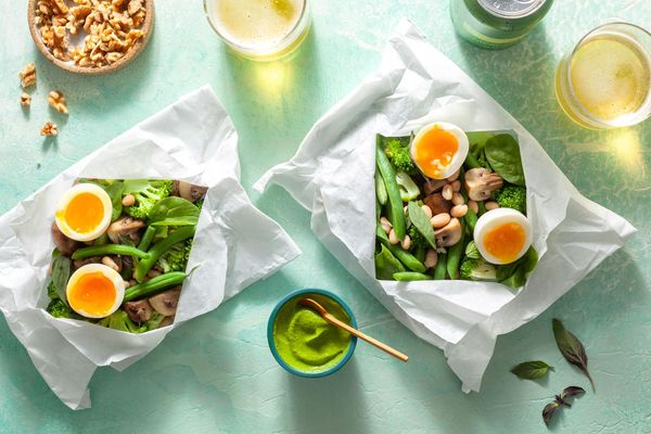 Vegetables in parchment with green goddess dressing and soft-cooked eggs