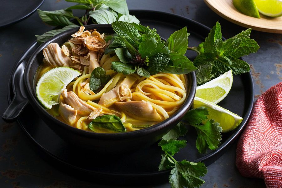 Thai curried chicken noodle soup with baby greens