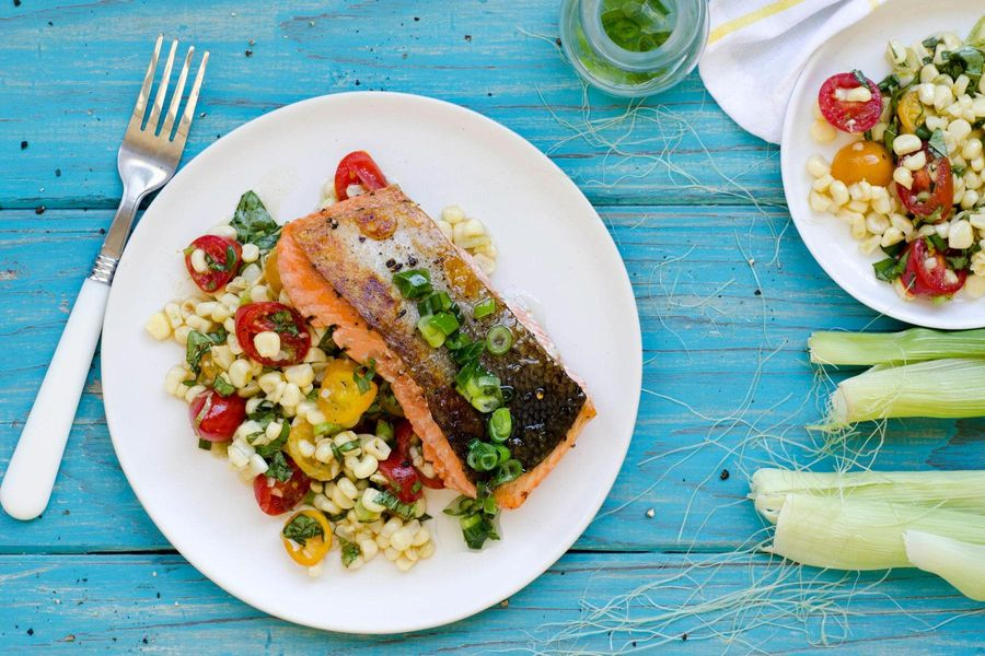 Seared salmon with corn, cherry tomato and basil salad