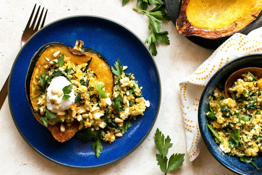 Bulgur-stuffed acorn squash with feta and spinach