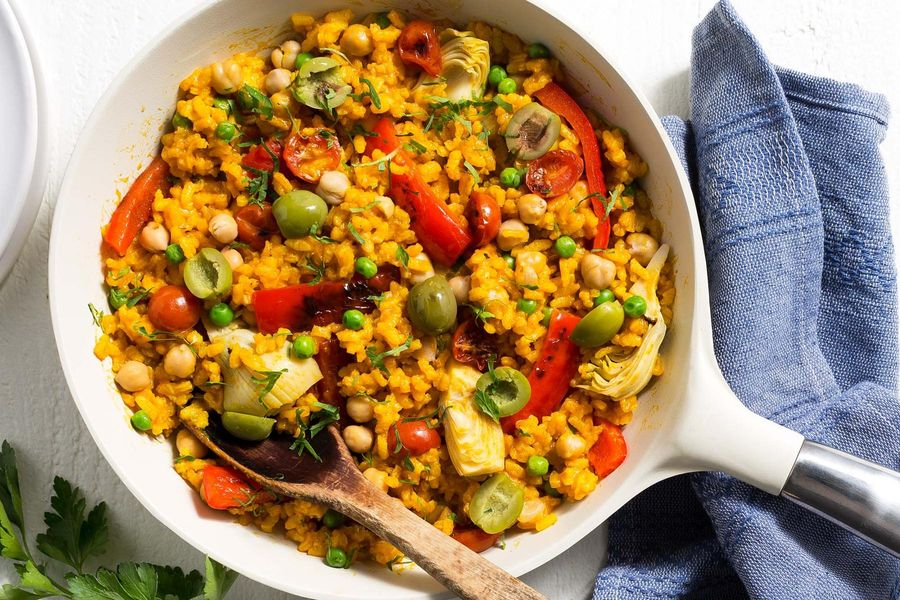 Chickpea paella with artichoke hearts, bell pepper, and tomatoes image