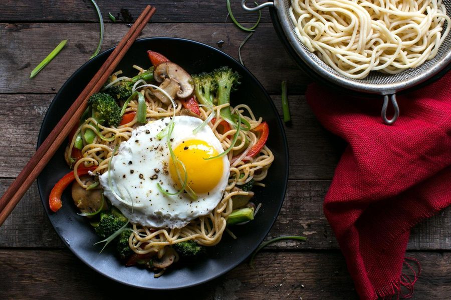 Stir-fried egg noodles with sesame sauce and a fried egg