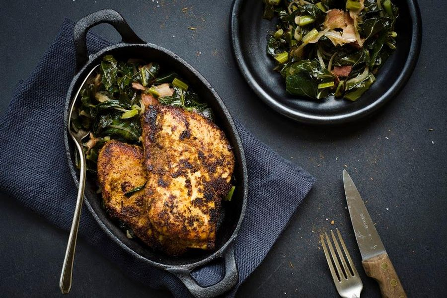 Blackened chicken with bacon-braised collard greens