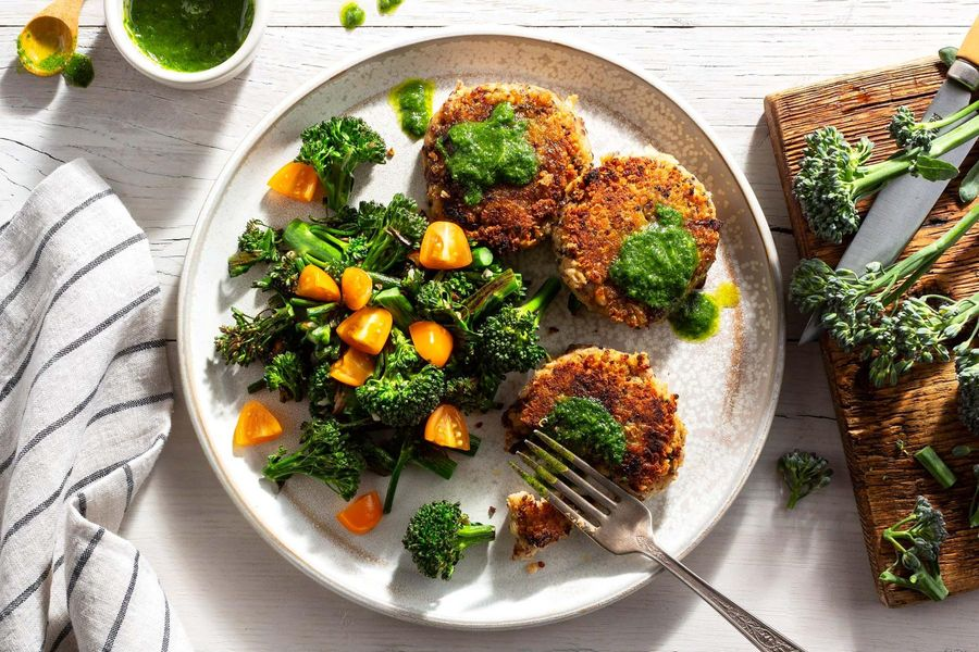 Quinoa–white bean fritters with baby broccoli and basil pesto