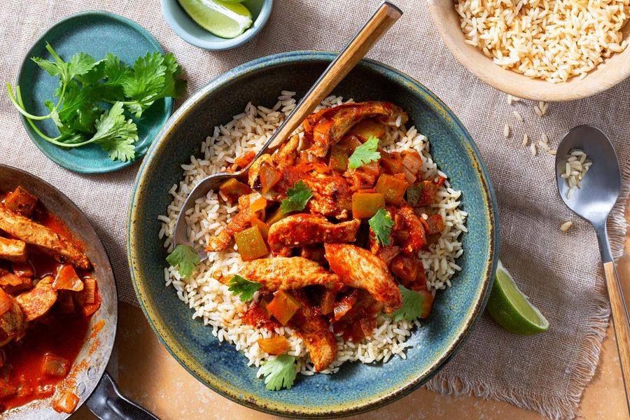 Ecuadorian chicken stew with bell pepper and brown rice