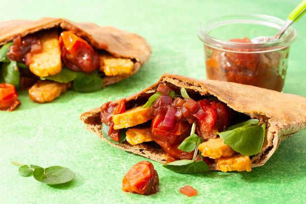Crispy tempeh pita pockets with watercress and tomato-onion jam