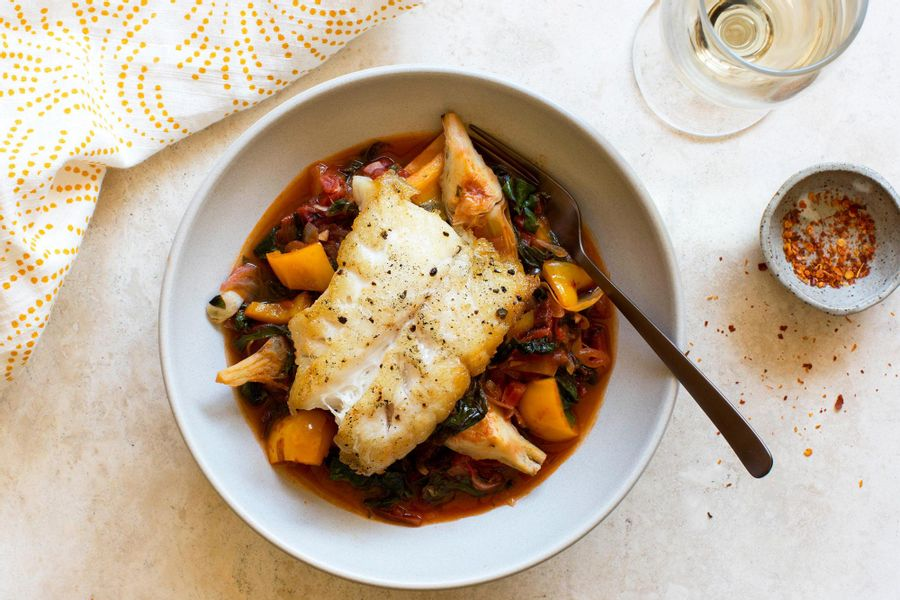 Pan-roasted Pacific cod with braised bell pepper, artichokes and tomato