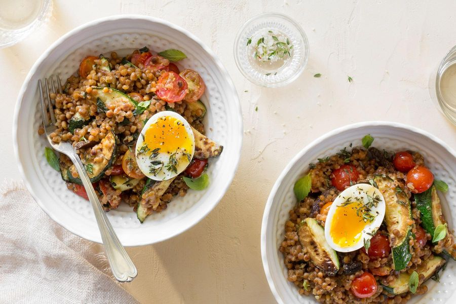 Fregola risotto with soft-cooked eggs, zucchini, and tomatoes