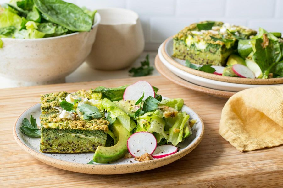 Quinoa strata with spinach, feta, and green goddess salad