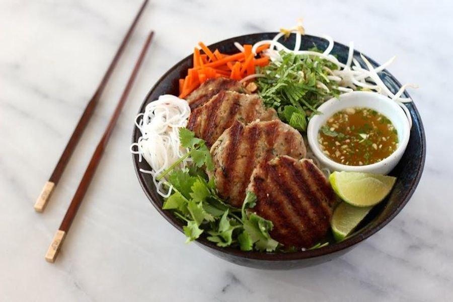 Vietnamese noodles with lemongrass pork patties, mint and lime