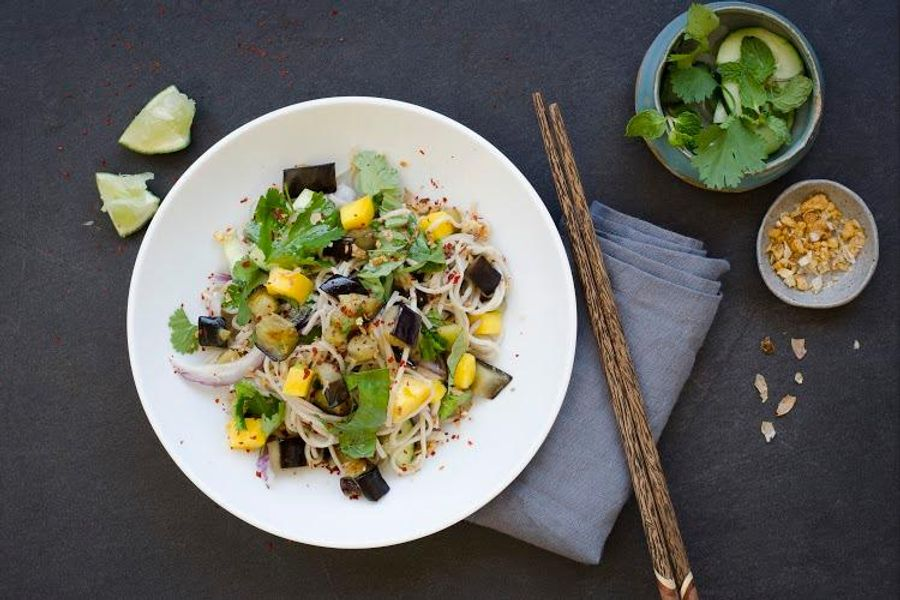 Soba noodle salad with charred eggplant, mango and fresh herbs