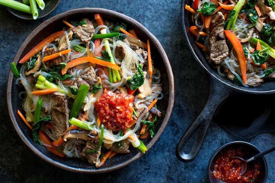 Korean steak japchae with glass noodles and stir-fried vegetables