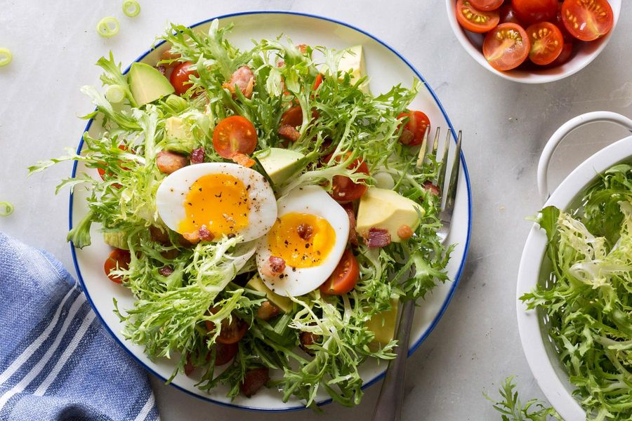Frisée salad with pancetta, avocado, and soft-cooked eggs