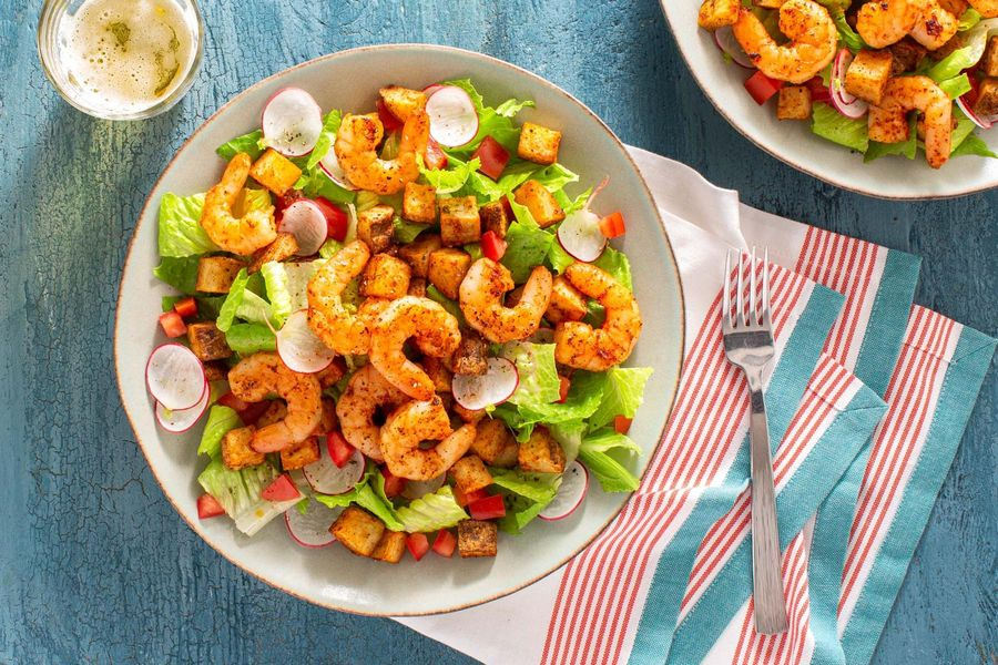 Chipotle shrimp and Cajun-spiced potato on a crisp mixed salad