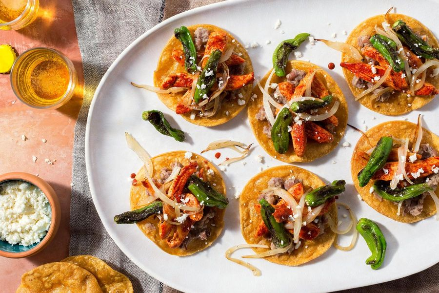 Yucatán chicken tostadas with charred shishito peppers and refried beans