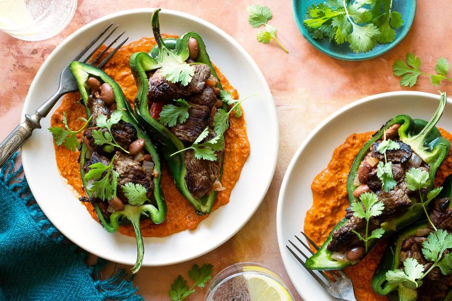 Chiles rellenos with sirloin steak strips, pinto beans, and romesco