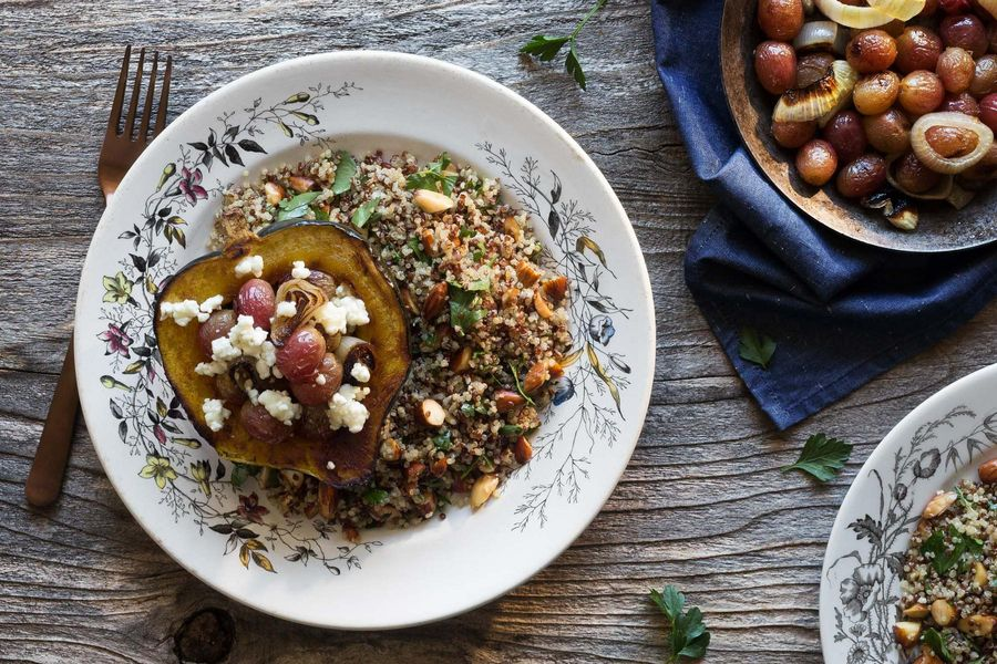 Roasted acorn squash with grapes, goat cheese, and quinoa image