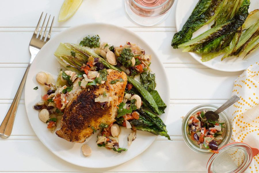 Harissa-rubbed chicken with artichoke tapenade and seared romaine