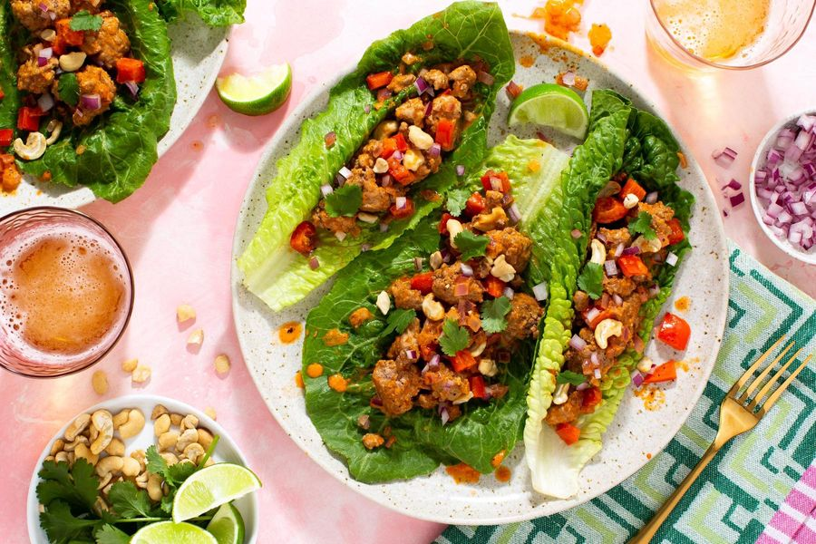 Thai lettuce cups with pork curry, crushed cashews, and fresh lime
