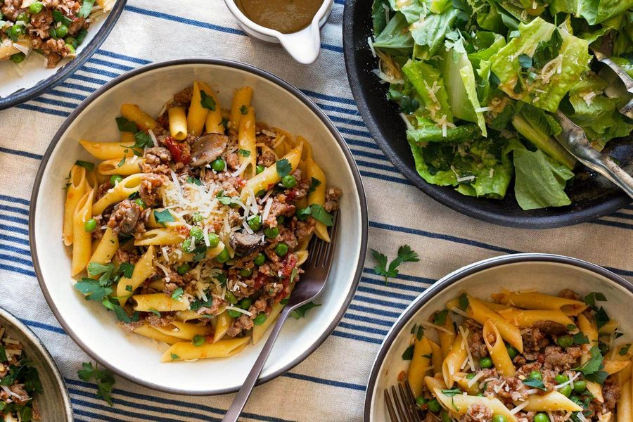 Italian sausage ragù with gluten-free penne and peas