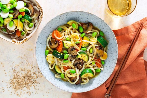 Japanese curry udon with carrots, mushrooms, and edamame