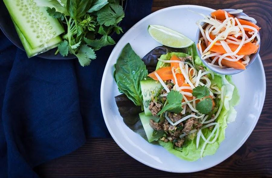 Steak lettuce wraps with fresh herbs and bean sprouts