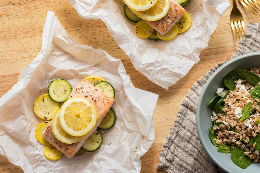 Salmon and summer squash in parchment with Mediterranean farro salad