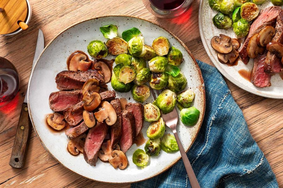 Steaks with mushroom pan sauce and Brussels sprouts