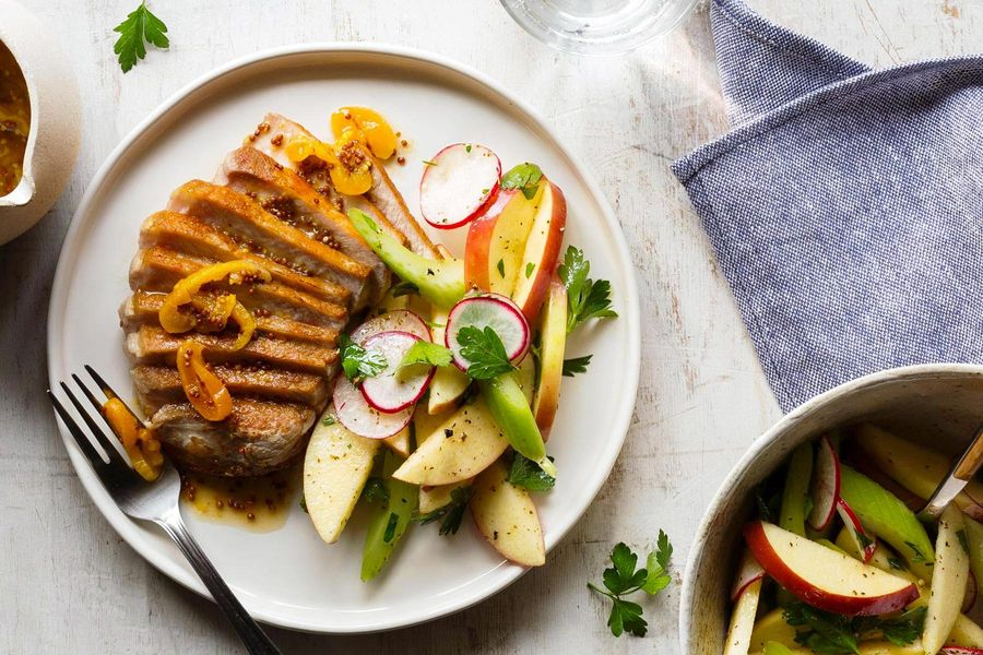 Pork chops with dried apricot mostarda and tomato-celery salad