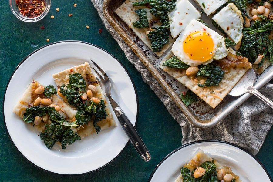 Flatbreads with fried eggs and kale-white bean salad