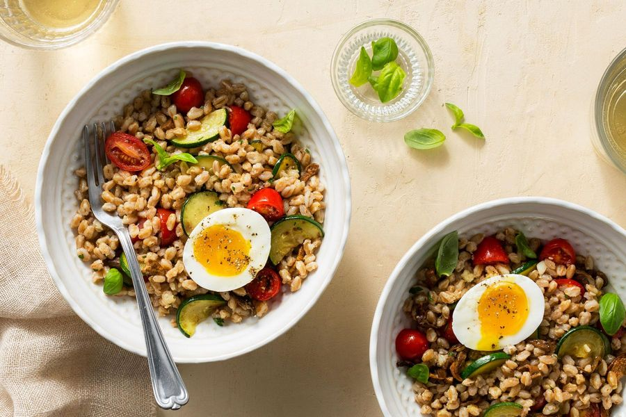 Farro risotto with zucchini, tomatoes, and soft-cooked eggs
