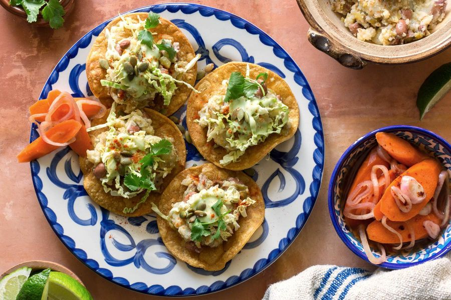Tex-Mex tostadas with pickled carrots and avocado crema