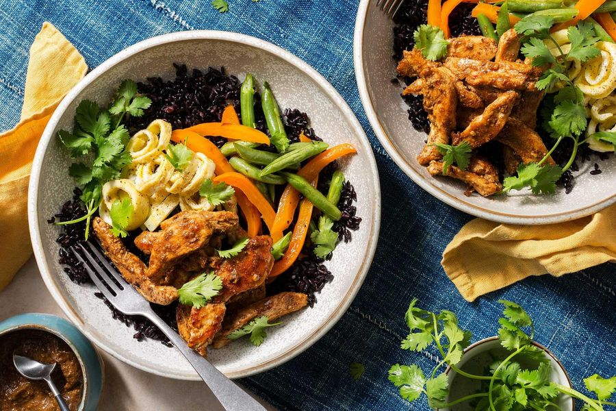 Tamarind chicken over black rice with bell pepper and egg ribbons