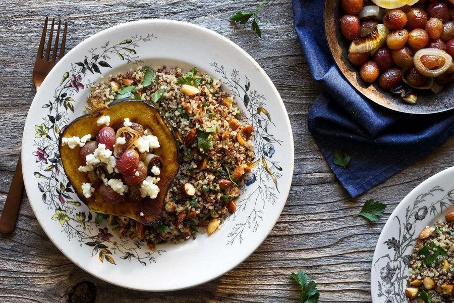 Roasted acorn squash with grapes, goat cheese, and quinoa