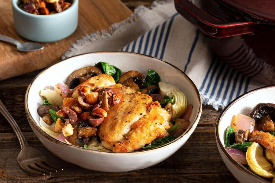 Braised chicken with mushrooms, artichokes, and almond-olive relish